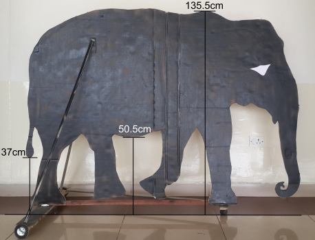 Cardboard elephant cutout, with dimensions overlayed.
