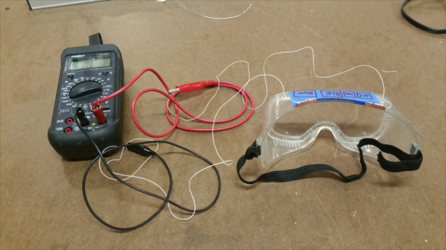 Copper pads connected to probes of the multimeter, in 20M resistance measuring mode.