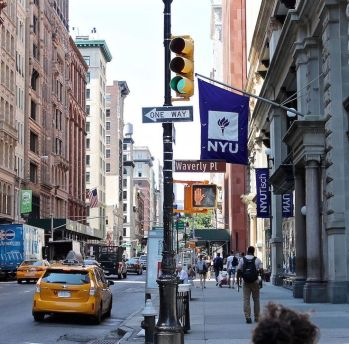 The NYU flags are a common theme binding buildings in a scattered campus.