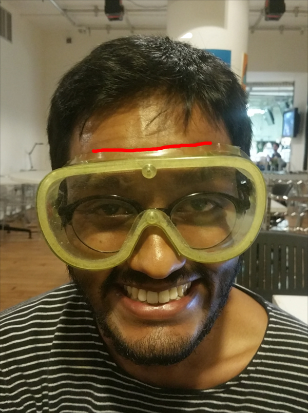 Safety glasses on forehead