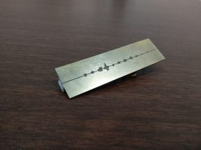 The etching on the back represents an audio file.